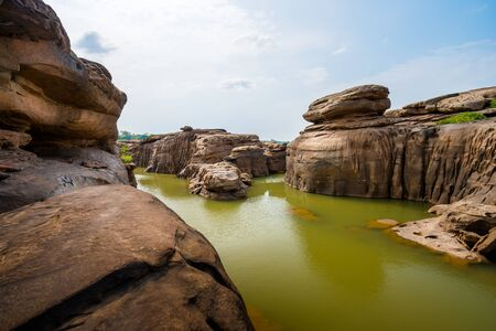 Amazing of rocks, Natural of rock canyon in mekhong river in summer, Hat Chom Dao, Ubon Ratchathani province, North east Thailand Фото со стока