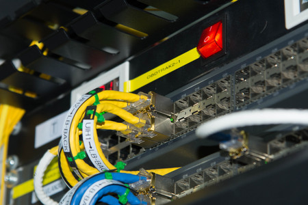 Network cables connected to ethernet ports. 写真素材