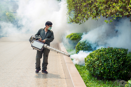 The man fogging to eliminate mosquito for prevent spread dengue fever Reklamní fotografie - 76229827