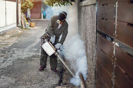 Man spraying fogging, eliminating mosquitoes, stopping the spread of dengue fever Reklamní fotografie