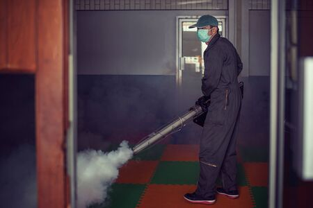Man work fogging to eliminate mosquito for preventing spread dengue fever and zika virus 스톡 콘텐츠 - 132084817