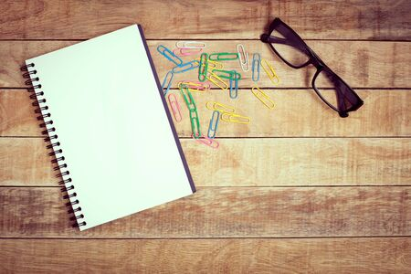 Notebook and glasses on wood table for work Stockfoto
