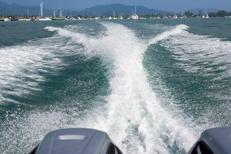 Ocean waves from a speed boat Фото со стока