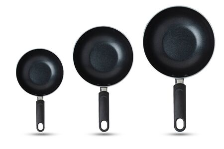 Pans, sorted from small to large, Kitchen equipment concept