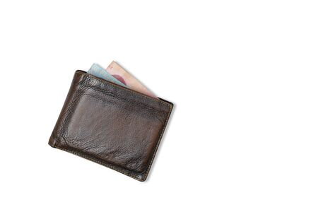 Top view brown wallet with money in the bag on white background 版權商用圖片