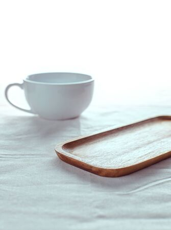 Empty wooden plate on the table and has a white background