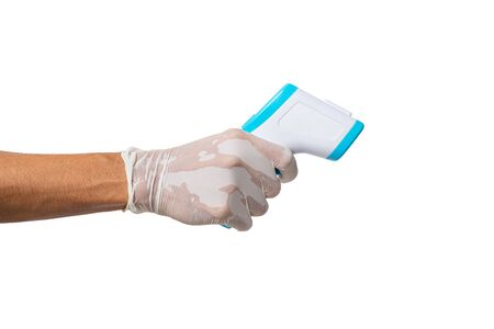 Hand holding Infrared thermometer for measuring body temperature on white background and clipping path