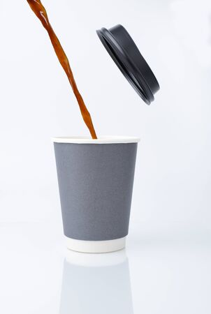 Pour the coffee water onto a paper cup with lid.