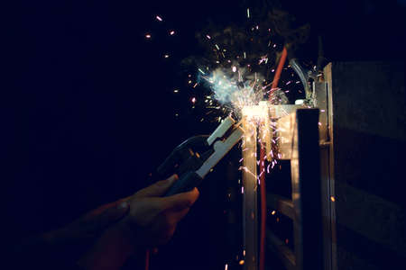 Sparks from welding at night
