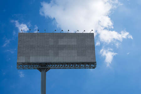 Blank billboard  with blue sky for an outdoor advertising poster 版權商用圖片