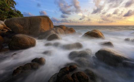 Many rocks are naturally shaped by the beach in the monsoon season. Stock Photo