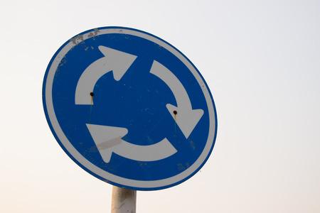roundabout: roundabout sign Stock Photo