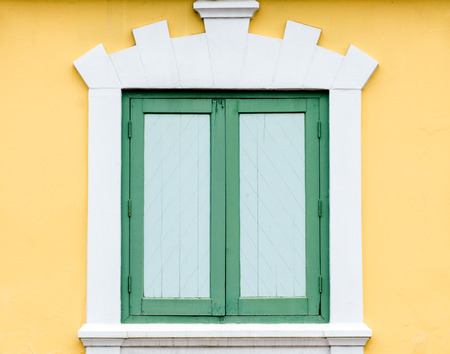 Green window on yellow wall of building Department of Defense of Thailand photo