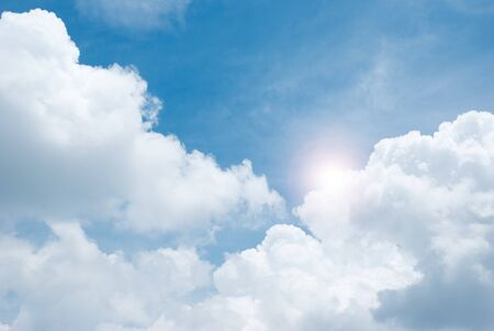 Blue sky with clouds and sun Stock Photo - 9789226