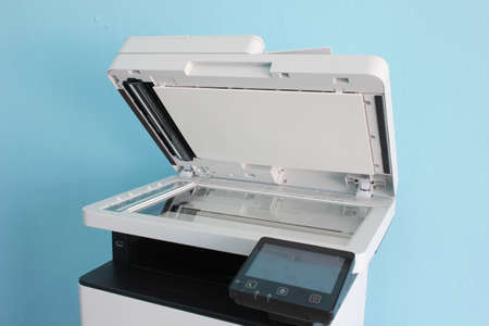photocopier is a machine that makes paper copies of documents and other visual images ,close-up multi-function device, printer scanner, copier.