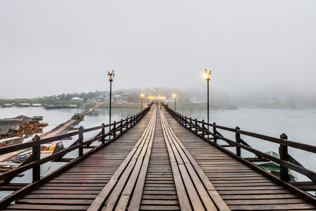 Wooden Mon Bridge at Sang kra Buri in Thailand. Sang kra Buri is a beautiful and peaceable places. There is The wooden Bridge, which is a popular bridge.