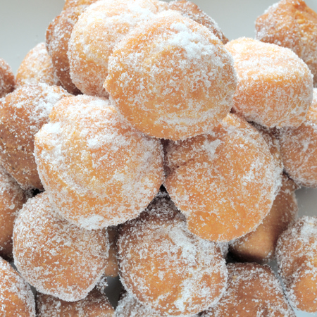 castagnole, fried pastries with caster sugar, top view, close up, square format, Italian dessert or snack for carnival