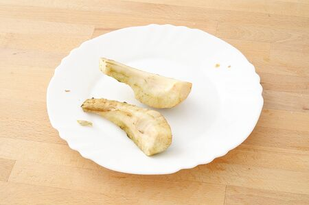 forgotten snack, two pear slices peeled and left to rot on the kitchen table