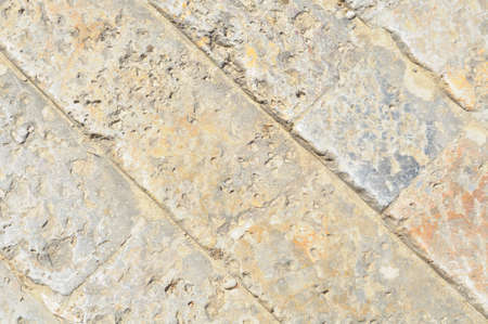 Monteriggioni, stone floor, close up of an ancient street in the medieval Tuscany town, Italy