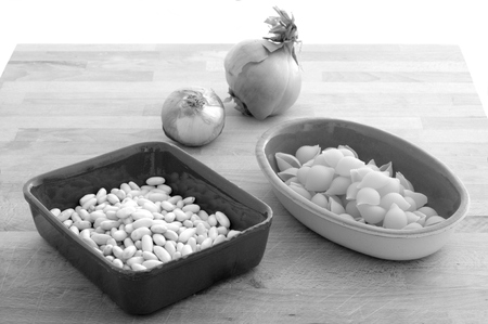 ingredients for peasant soup, pasta and onion beans, black and white