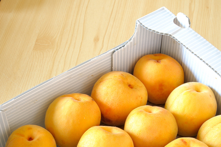 top view of fresh organic apricots in a box Stock Photo