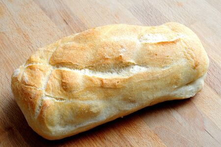 ciabatta, typical italian bread, from above on wooden Banque d'images - 132084517