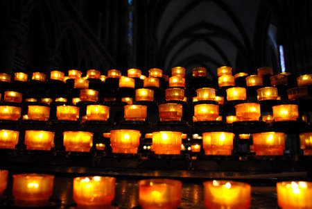 esotericism: worrying sequence of lit candles o Stock Photo