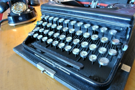 Featured on old typewriter and telephone
