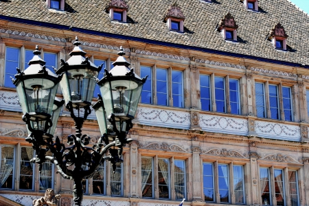 institutional: antique lamp with institutional building in the center of Strasbourg Stock Photo