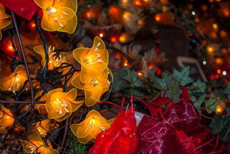 Christmas lights decorated with handcrafted flowers photo