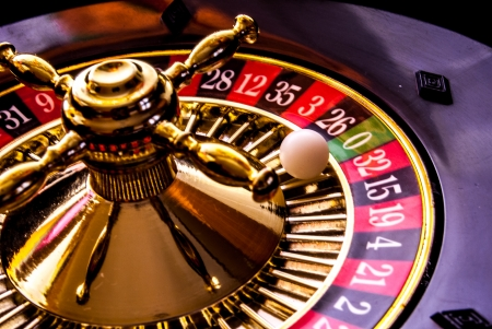 casinos: roulette game with game table and green poker chips Stock Photo