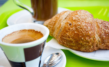 a tasty breakfast with coffee, cappuccino and biosche photo