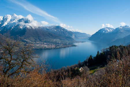 liszt: picturesque landscape with the blue water of Lake Como surrounded by the Alps of Lombardy Stock Photo