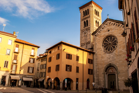 neo gothic: a charming square with a small church and bell tower in the town center of Como
