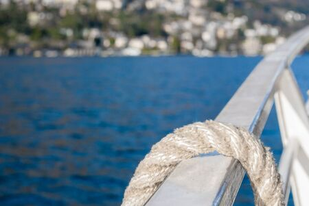 a knotted rope to rescue people at sea photo