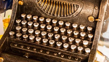 toy model of typewriter black with white keys photo