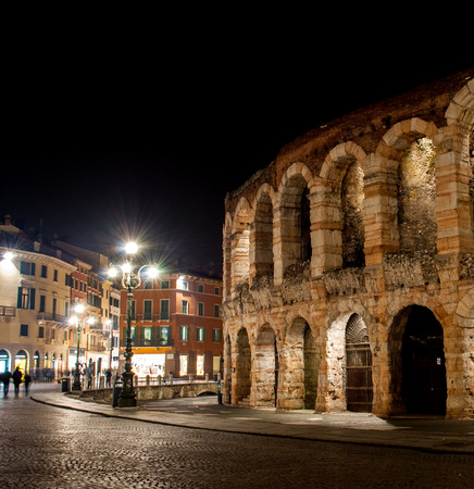 Arena of Verona located in the city center is a tourist destination for millions of visitors photo