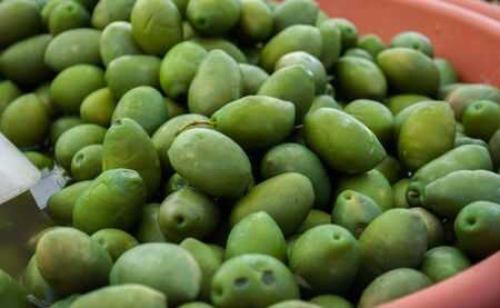 street market: at a street market are selling green and black olives Stock Photo