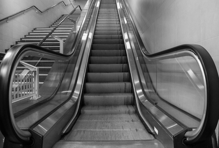 await: escalators in the city of Milan await the arrival of commuters