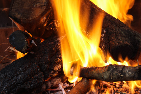 burning wood to heat homes and cook food Stock Photo