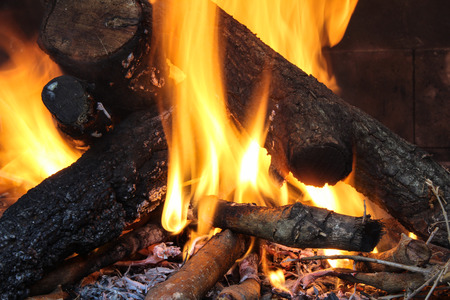 heat radiation: burning wood to heat homes and cook food Stock Photo