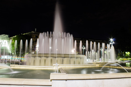 obelisk stone: fountain in the city of Milan during a summer night