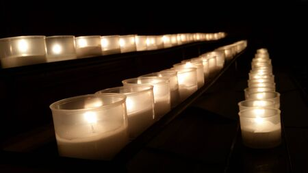 recordar: candles in a row to remember the dead and saints