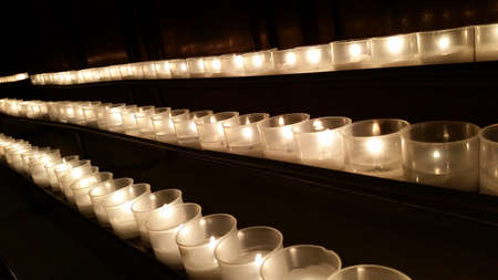 seance: candles in a row to remember the dead and saints