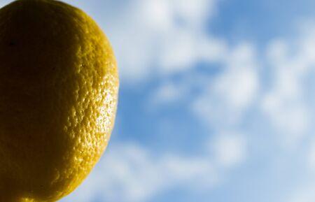 Lemon floating in the sky like a balloon Stock Photo