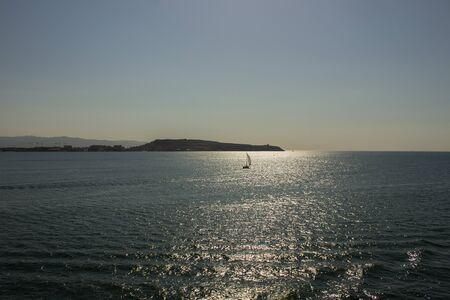 small sailing ship sailing on calm sea Stock Photo
