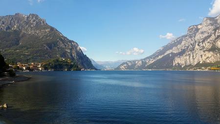 the intense blue of the alpine lake ` Stock Photo