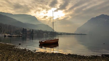 beautiful golden hues of the lake water Standard-Bild