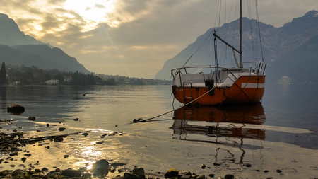 beautiful golden hues of the lake water Stock Photo