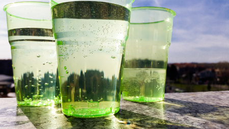 three glasses of water on the window sill